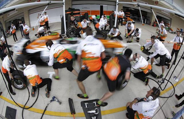 Force India pit crews practice a tire change on Adrian Sutil of Germany's car in preparation for the Formula One U.S. Grand Prix auto race at the Circuit of the Americas, Thursday, Nov. 14, 2013, in Austin, Texas. (AP Photo/David J. Phillip)