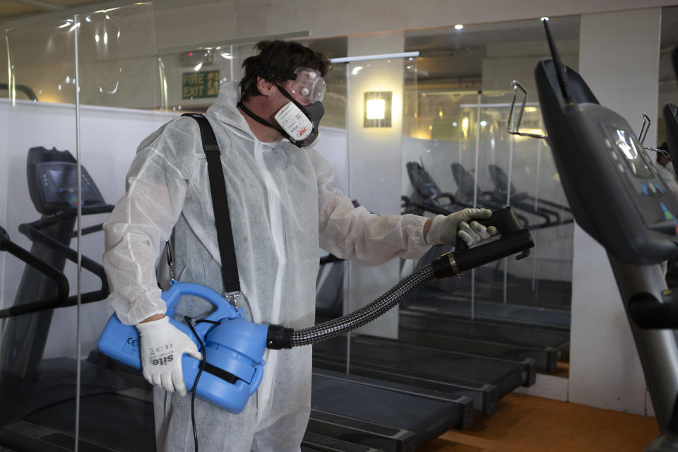 A man in a hazmat suit inside Oasis Gym as Gyms and leisure centres in the UK prepare for reopening on Saturday 25th July by installing social distancing and COVID 19 compliant signs. On July 22, 2020 in Stanford Le Hope. UK. (Photo by Jacques Feeney/MI News/NurPhoto via Getty Images)