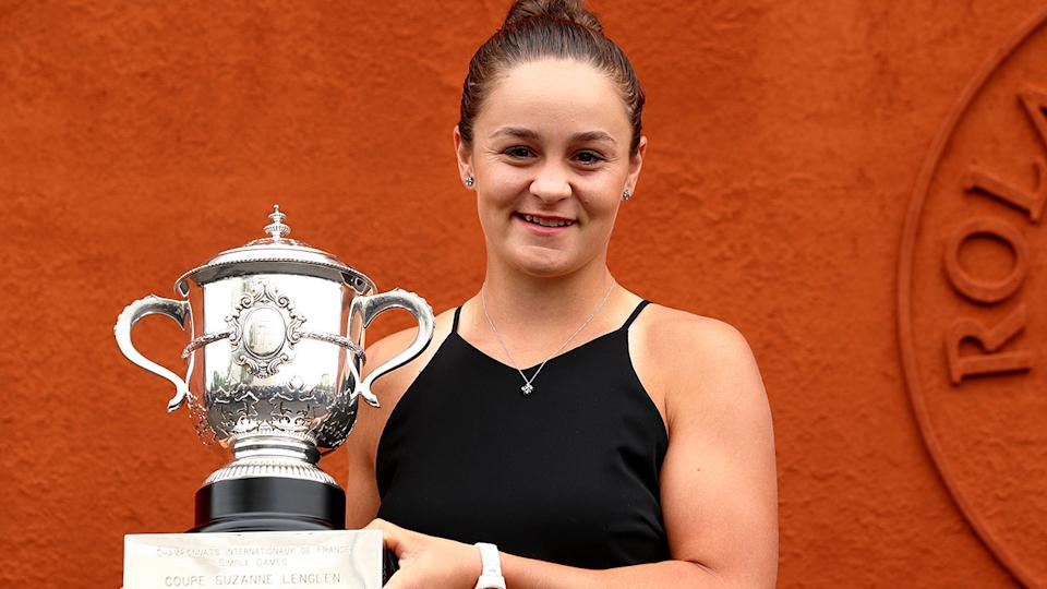 Ash Barty is pictured here with the first grand slam trophy of her tennis career.