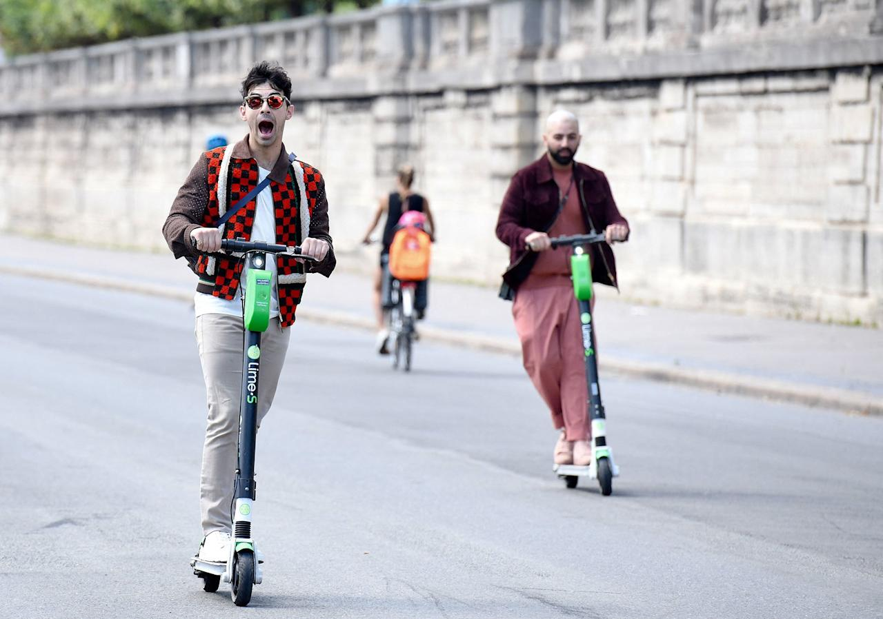 Ahead of his second wedding celebration to bride Sophie Turner, Joe Jonas enjoys the streets of Paris on a scooter on Saturday.