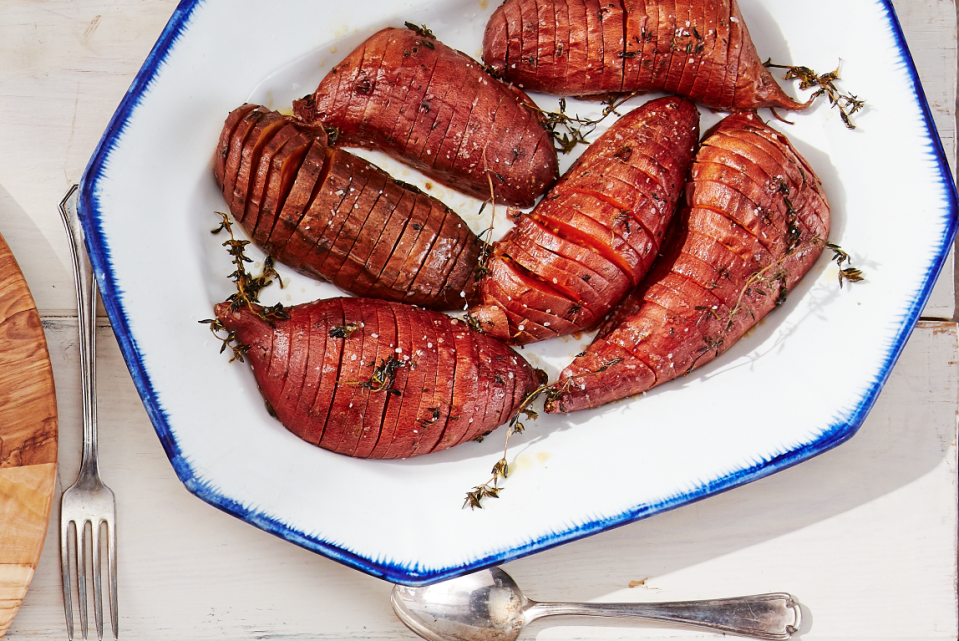 """<p>Who doesn't love potatoes? Whether it's <a href=""""https://www.countryliving.com/food-drinks/recipes/a35825/russet-potato-fries/"""" rel=""""nofollow noopener"""" target=""""_blank"""" data-ylk=""""slk:russet potato fries"""" class=""""link rapid-noclick-resp"""">russet potato fries</a> and Yukon <a href=""""https://www.countryliving.com/food-drinks/recipes/a934/golden-home-fries-3035/"""" rel=""""nofollow noopener"""" target=""""_blank"""" data-ylk=""""slk:golden home fries"""" class=""""link rapid-noclick-resp"""">golden home fries</a>, sign us up as fan. But we have a special appreciation for the mighty sweet potato. Practically any dish can be improved with a little sweet potato. And lest you start to think the humble orange spuds are only really meant for <a href=""""https://www.countryliving.com/food-drinks/g896/thanksgiving-side-dishes/"""" rel=""""nofollow noopener"""" target=""""_blank"""" data-ylk=""""slk:Thanksgiving side dishes"""" class=""""link rapid-noclick-resp"""">Thanksgiving side dishes</a> or as part of an <a href=""""https://www.countryliving.com/food-drinks/g1921/easy-fall-recipes/"""" rel=""""nofollow noopener"""" target=""""_blank"""" data-ylk=""""slk:easy fall recipe"""" class=""""link rapid-noclick-resp"""">easy fall recipe</a>, we are here to set you straight. From breakfast hash to asparagus pairing, from soup add-in to dessert sweetener, sweet potatoes are a great year-round ingredient. </p><p>Of course, we always love a classic fall <a href=""""https://www.countryliving.com/food-drinks/g3787/sweet-potato-casserole/"""" rel=""""nofollow noopener"""" target=""""_blank"""" data-ylk=""""slk:sweet potato casserole"""" class=""""link rapid-noclick-resp"""">sweet potato casserole</a> or a warm and cozy<a href=""""https://www.countryliving.com/food-drinks/g3806/sweet-potato-soup/"""" rel=""""nofollow noopener"""" target=""""_blank"""" data-ylk=""""slk:sweet potato soup"""" class=""""link rapid-noclick-resp""""> sweet potato soup</a> for a chilly evening—but why stop there? Think outside the box with sweet potato pizza crust, sweet potato enchiladas, sweet potato pancakes, sweet potato veggie burgers, and so much more"""