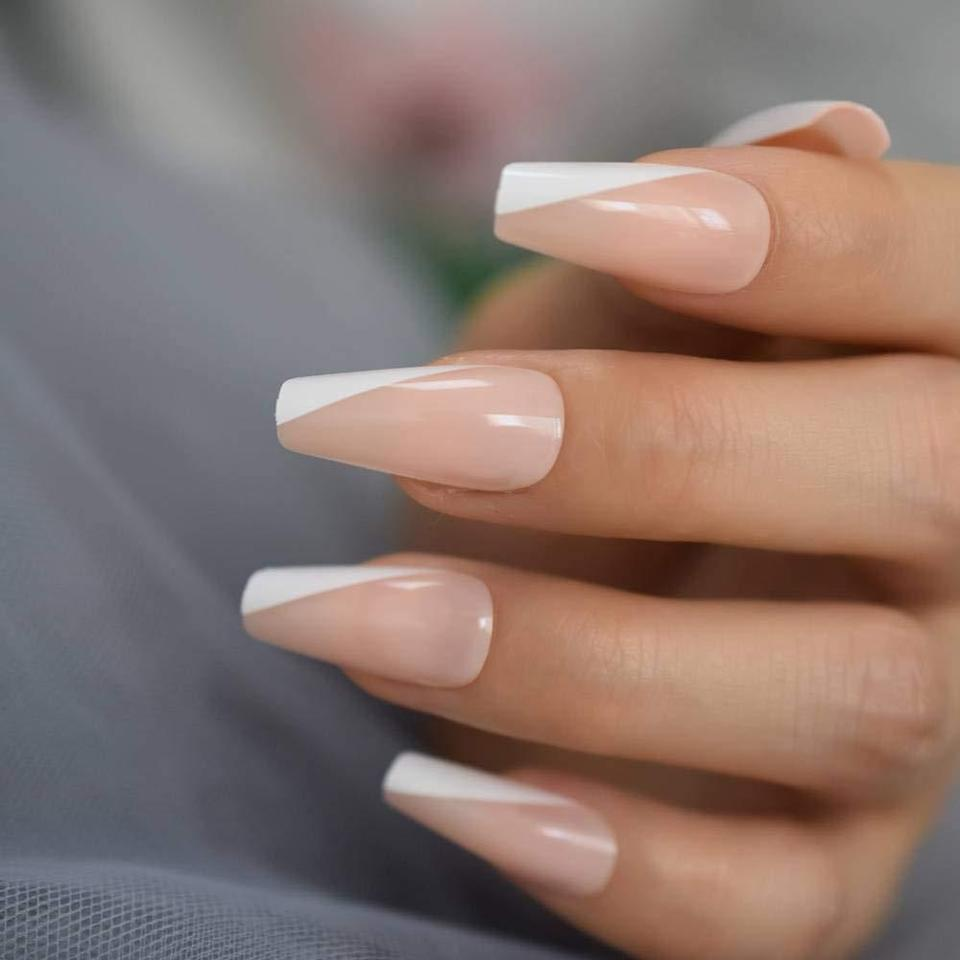"<p>The VM Direct Acrylic Fake Nails offer <a href=""https://www.allure.com/story/nail-trends-2020-nail-art-ideas?mbid=synd_yahoo_rss"" rel=""nofollow noopener"" target=""_blank"" data-ylk=""slk:ballerina/coffin"" class=""link rapid-noclick-resp"">ballerina/coffin</a> (which blew up in 2020) and stiletto shapes in 18 different colors and finishes to instantly glam up your nails. We're fans of these asymmetrical French tips, but plenty of monochrome reds, purples, yellows, and blacks are available if you prefer to forgo the art. Each set allocates 20 press-ons in 10 different sizes that you can further cut or file down to your preferred length. Keep in mind that you'll have to buy nail glue separately.</p> <p><strong>$10</strong> (<a href=""https://www.amazon.com/Sculpted-Stiletto-Extra-20pcs-cover/dp/B084M7Q3ZB"" rel=""nofollow noopener"" target=""_blank"" data-ylk=""slk:Shop Now"" class=""link rapid-noclick-resp"">Shop Now</a>)</p>"