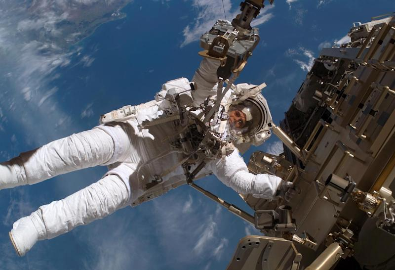This December 2006 image provided by NASA shows European Space Agency astronaut Christer Fuglesang working outside the International Space Station. A new study published in the journal Science found that astronauts traveling to Mars and back would be exposed to a high dose of radiation. NASA wants to send a crew to orbit the red planet by the mid-2030s. (AP Photo/NASA)
