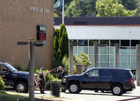 Police officers enter the building after a shooting at Reynolds High School in Troutdale, Oregon
