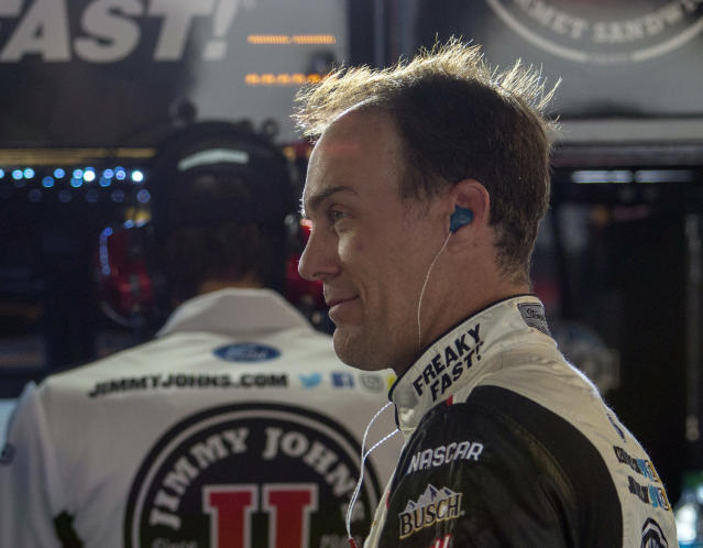 "<a class=""link rapid-noclick-resp"" href=""/nascar/sprint/drivers/205/"" data-ylk=""slk:Kevin Harvick"">Kevin Harvick</a> prepares for practice for the NASCAR Cup Series auto race at Martinsville Speedway in Martinsville, Va., Saturday, March 24, 2018. (AP Photo/Matt Bell)"