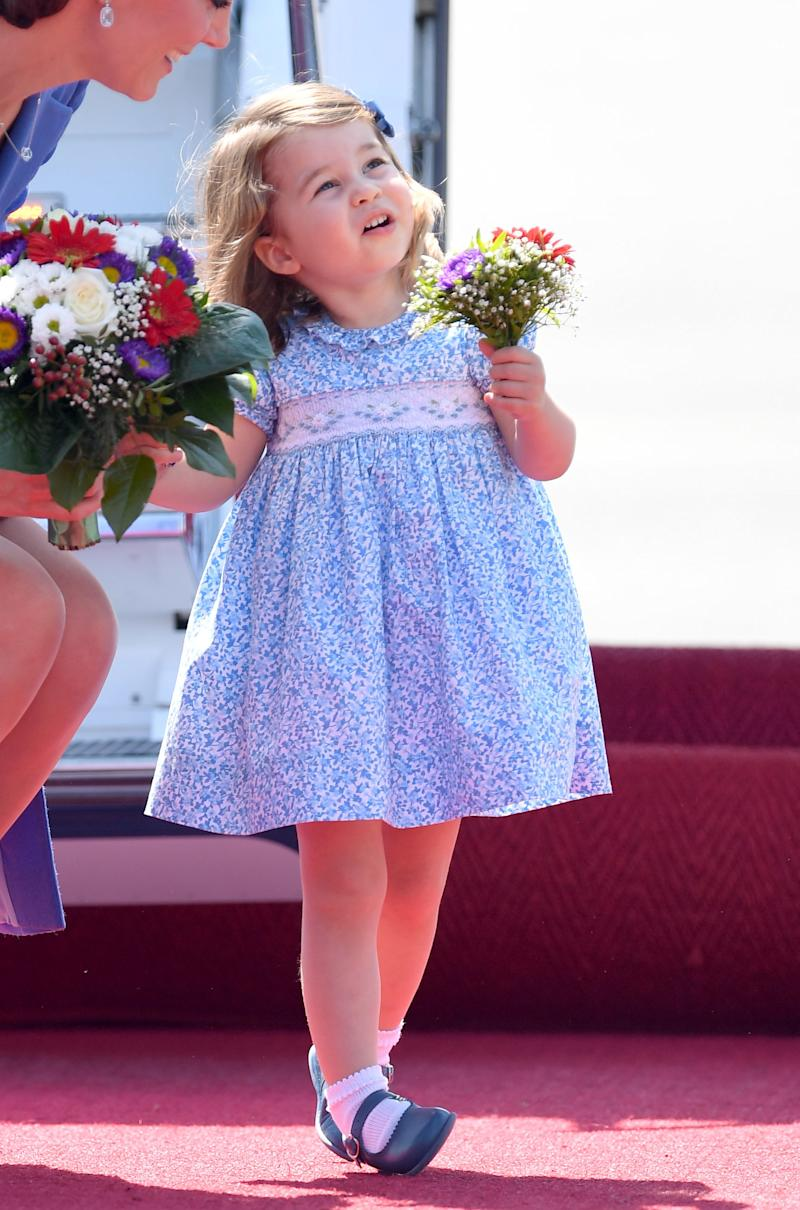 Princess Charlotte makes the perfect flower girl.  (Karwai Tang via Getty Images)
