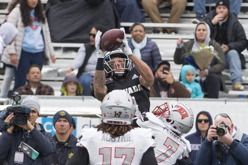 Nevada wide receiver Elijah Cooks, top, goes up for a pass over UNLV's Jericho Flowers (7) in the first half of an NCAA college football game in Reno, Nev., Saturday, Nov. 30, 2019. (AP Photo/Tom R. Smedes)