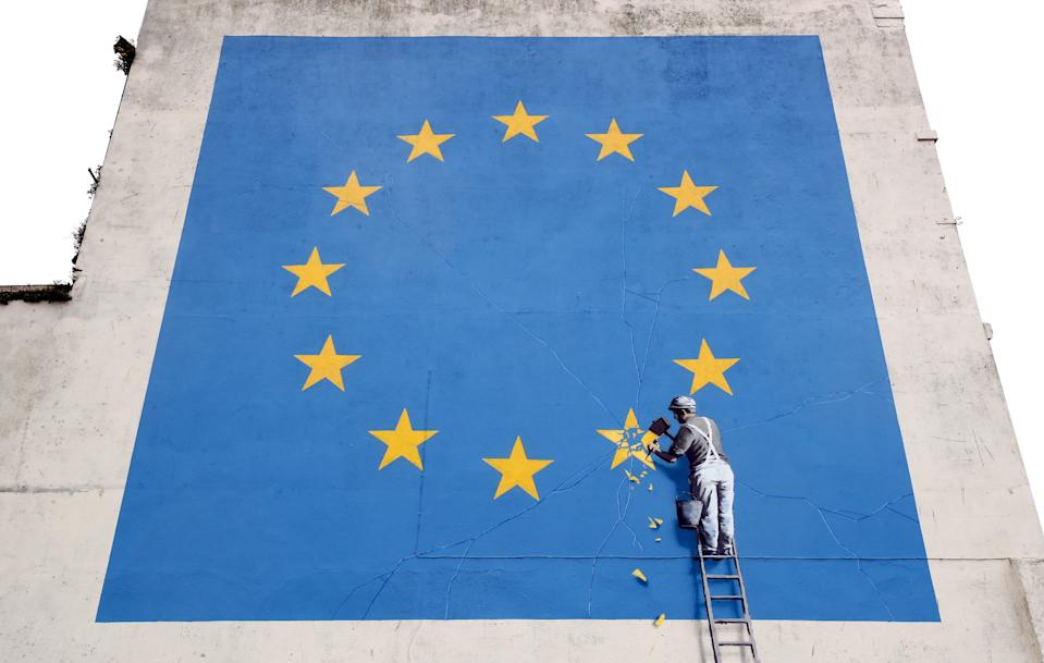 A view of a mural by artist Banksy of a workman removing a star from the EU flag which appeared yesterday near the ferry terminal in Dover, Kent.