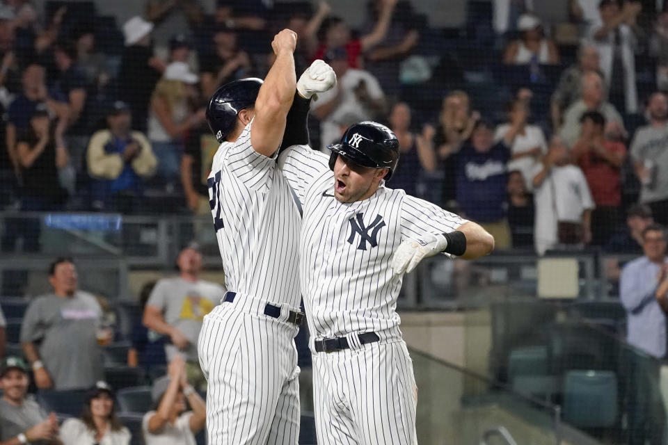 New York Yankees' Joey Gallo, right, celebrates his three-run home run with Giancarlo Stanton during the seventh inning of the team's baseball game against the Seattle Mariners, Thursday, Aug. 5, 2021, in New York. (AP Photo/Mary Altaffer)