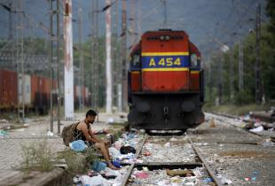 A Syrian refugee rests at Idomeni train station where refugees and migrants are gathering before crossing Greece's border to Macedonia near the Greek village of Idomeni, September 11, 2015. (Photo: Yannis Behrakis/Reuters)