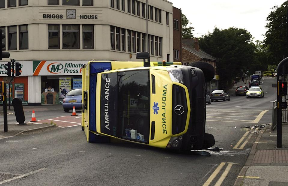 Emergency services are attending a 'serious' crash involving an ambulance and a car in Commercial Road at Ashley Cross which left the ambulance on its side, July 9 2021. See SWNS story SWBRambulance