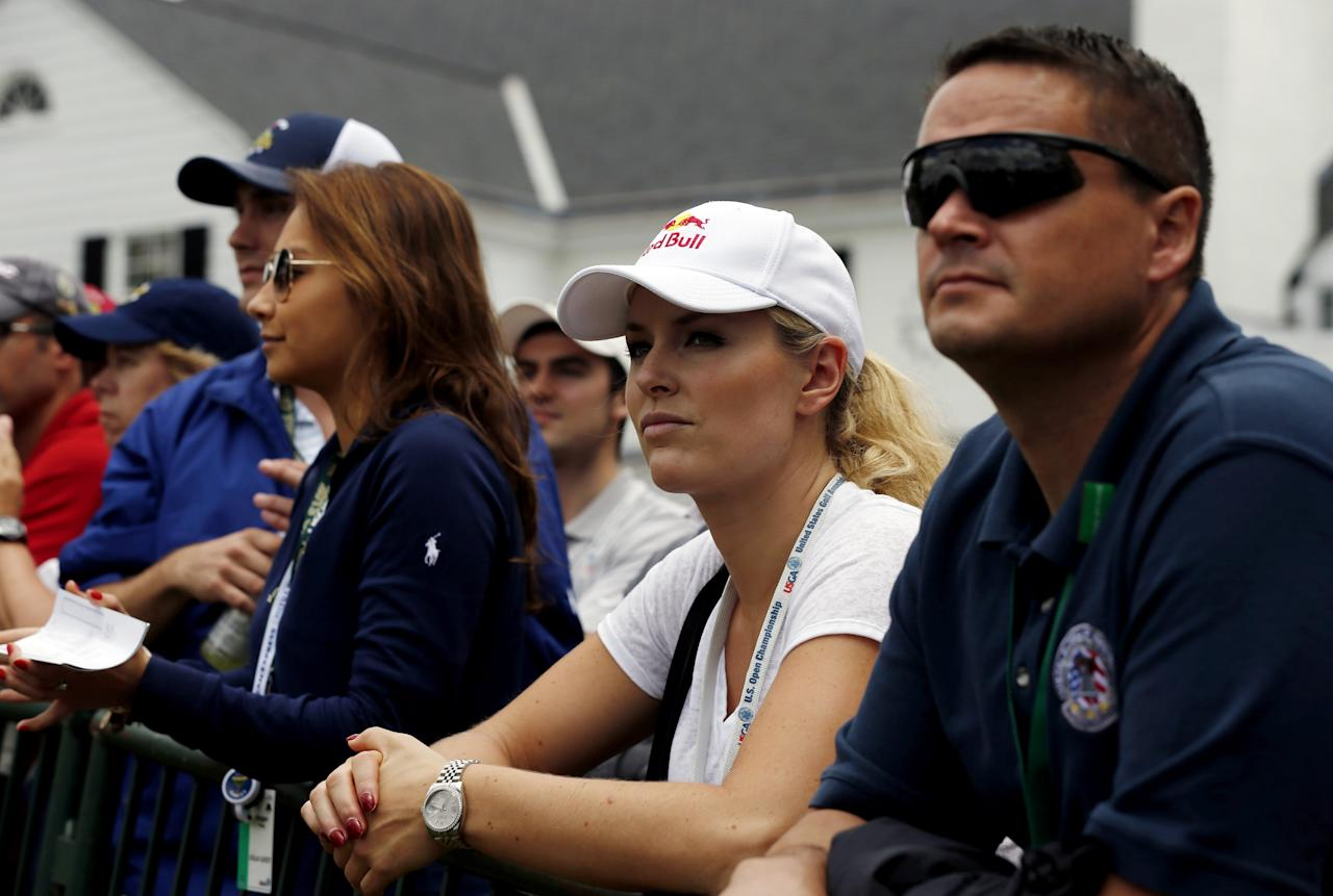 ARDMORE, PA - JUNE 14:  Skier Lindsey Vonn waits near the clubhouse as he watches Tiger Woods of the United States (not pictured) on the 18th hole during Round Two of the 113th U.S. Open at Merion Golf Club on June 14, 2013 in Ardmore, Pennsylvania.  (Photo by Scott Halleran/Getty Images)