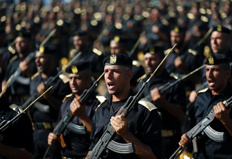 Members of the Palestinian security forces loyal to Hamas march during a graduation ceremony in Gaza City on December 4, 2014