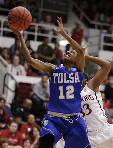 Tulsa's Taleya Mayberry (12) shoots a layup past Stanford's Amber Orrange (33) during the first half of a first-round game in a women's NCAA college basketball tournament on Sunday, March 24, 2013, in Stanford, Calif. (AP Photo/Ben Margot)