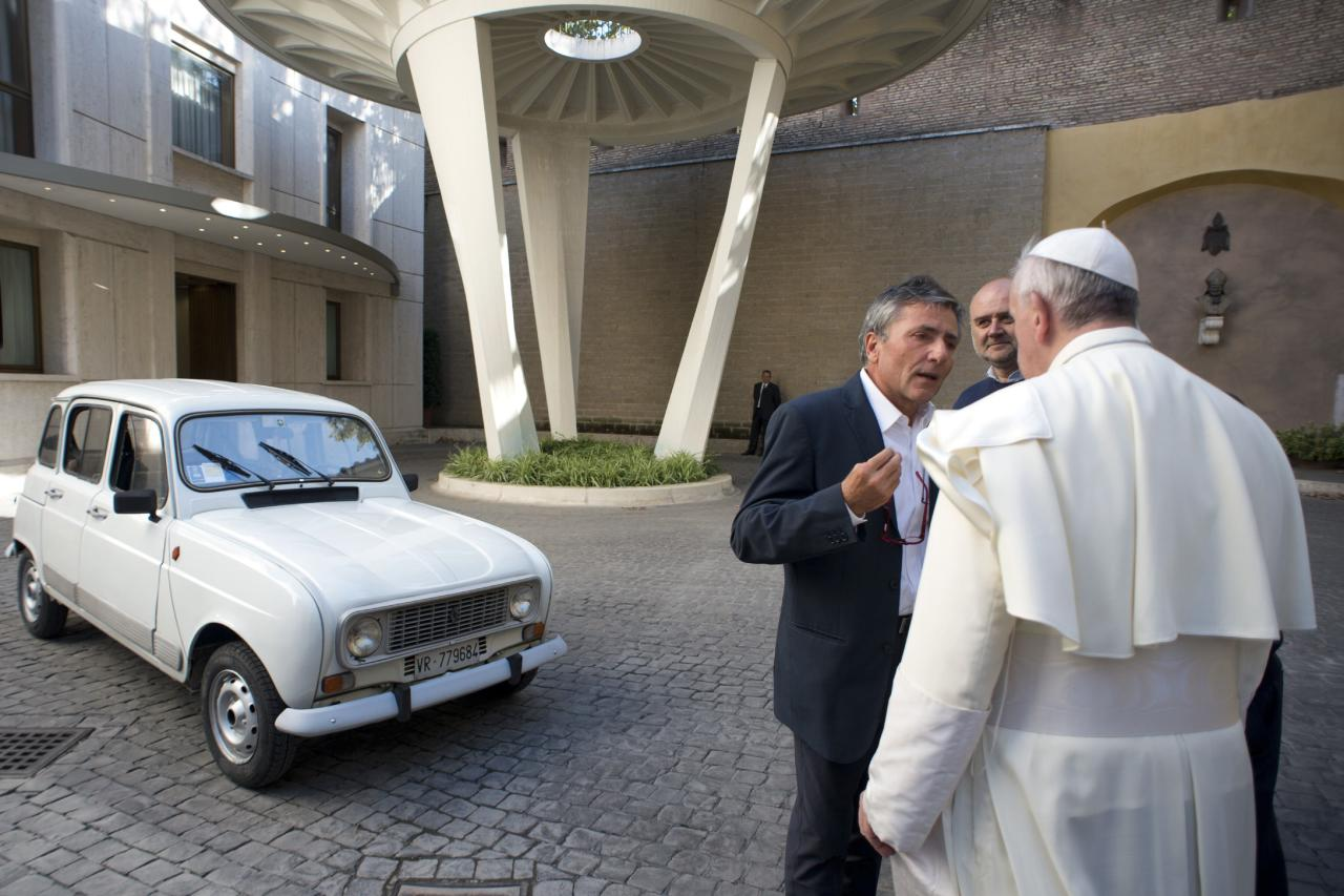 Pope Francis is presented with a Renault 4 car during a private audience with Don Renzo Zocca at the Vatican in this picture taken September 7, 2013 and released by Osservatore Romano September 10, 2013. REUTERS/Osservatore Romano (VATICAN - Tags: RELIGION)   ATTENTION EDITORS - THIS IMAGE WAS PROVIDED BY A THIRD PARTY. FOR EDITORIAL USE ONLY. NOT FOR SALE FOR MARKETING OR ADVERTISING CAMPAIGNS. NO SALES. NO ARCHIVES. THIS PICTURE IS DISTRIBUTED EXACTLY AS RECEIVED BY REUTERS, AS A SERVICE TO CLIENTS