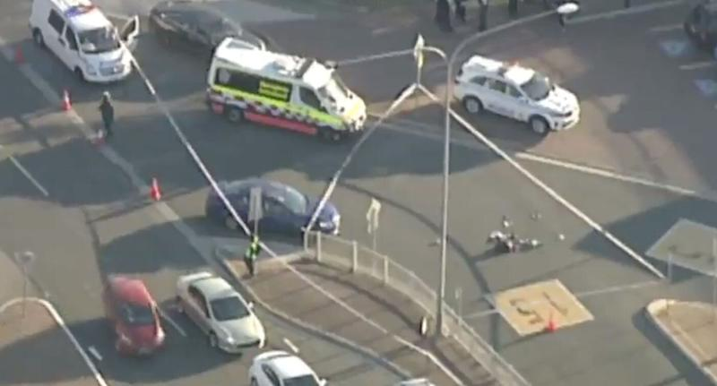 Police and ambulance on scene at the site of the shooting. Source: 7 News