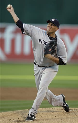 New York Yankees' Freddy Garcia works against the Oakland Athletics in the first inning of a baseball game on Thursday, July 19, 2012, in Oakland, Calif. (AP Photo/Ben Margot)