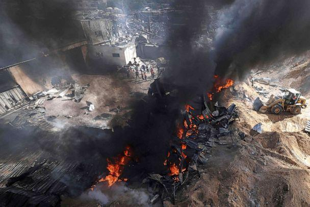 PHOTO: Palestinian firefighters douse a huge fire in the northern Gaza Strip, on May 17, 2021. (Mahmud Hams/AFP via Getty Images)