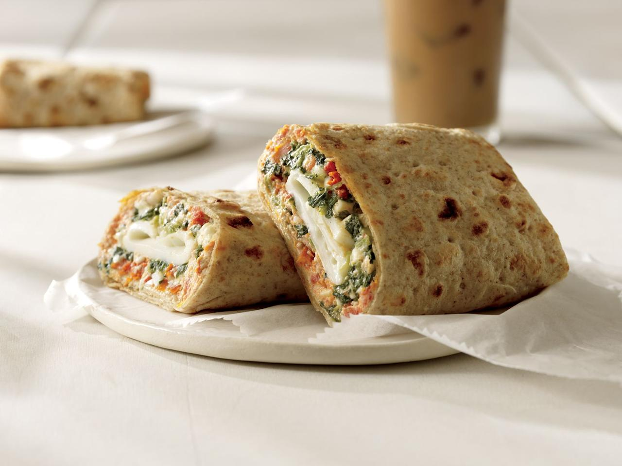 """<p>Thanks to a substantial selection of ready-to-go meals, Starbucks is a great option when you're pressed for time. """"I go for Starbucks, which has a good selection of breakfast items in addition to my go-to order of an Americano with steamed non-fat milk,"""" says <a href=""""http://jessicaiveyrdn.com/"""">Jessica Ivey</a>, RDN.</p><p><strong>WHAT TO EAT</strong></p><p><strong>Spinach, Feta And Cage-Free Egg White Breakfast Wrap: </strong><strong></strong>""""This is one of my favorites because it's packed with 15 grams of protein to keep me full and satisfied,"""" says Ivey.</p><p><a href=""""https://www.myfitnesspal.com/food/calories/41680085""""><em>Per serving</em></a><em>: 290 calories, 10 g fat (3 g saturated), 33 g carbs, 4 g sugar, 830 mg sodium, 6 g fiber, 9 g protein</em></p><p><strong><em></em>Hearty Blueberry Oatmeal: </strong>""""I love this because it provides five grams of filling fiber,"""" says Ivey.</p><p><a href=""""https://www.starbucks.com/menu/food/hot-breakfast/steel-cut-oatmeal-with-blueberries?foodZone=9999""""><em>Per serving</em></a><em>: 220 calories, 2.5 g fat (0.5 g saturated), 43 g carbs, 13 g sugar, 125 mg sodium, 5 g fiber, 5 g protein</em></p>"""