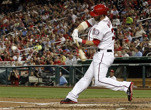 Washington Nationals' Bryce Harper hits a solo home run during the fourth inning of an interleague baseball game against the Chicago White Sox at Nationals Park, Wednesday, April 10, 2013, in Washington. (AP Photo/Alex Brandon)