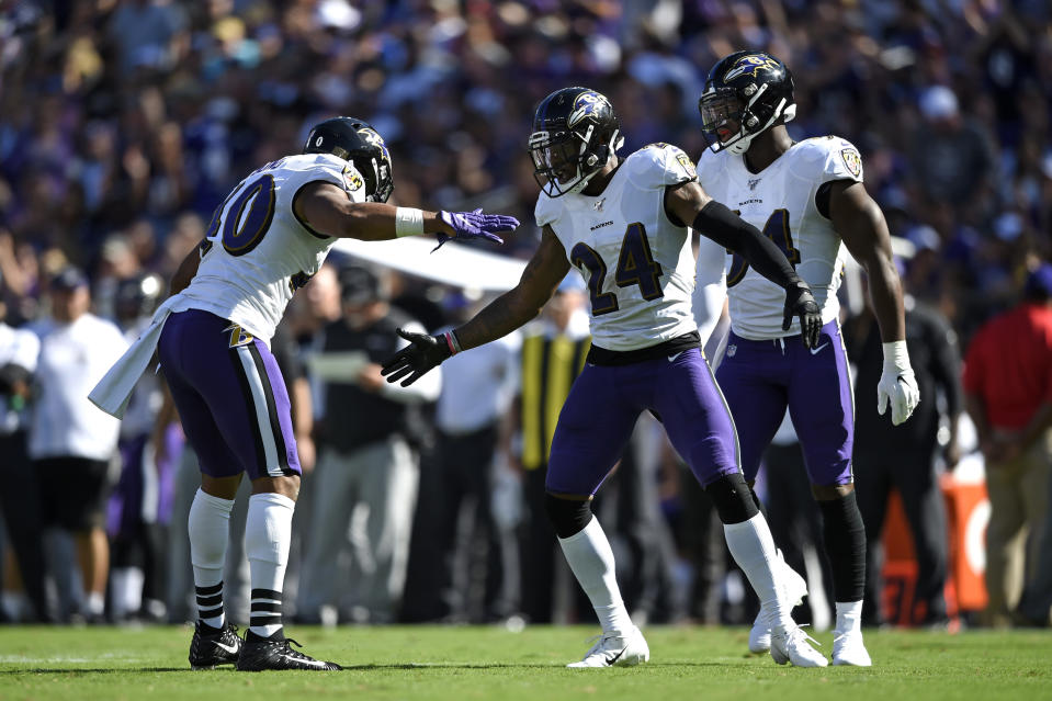 Baltimore Ravens cornerback Brandon Carr (24) celebrates with teammate Kenny Young, left, after a play in the second half of an NFL football game against the Arizona Cardinals, Sunday, Sept. 15, 2019, in Baltimore. (AP Photo/Gail Burton)