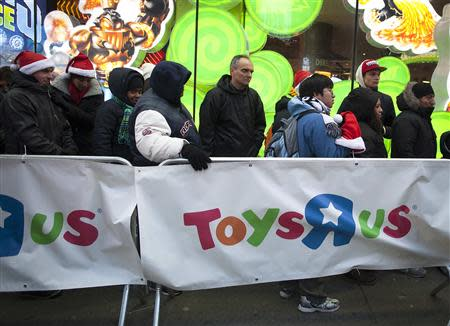"""People line up outside a Toys""""R""""Us store in Times Square before their Black Friday Sale in New York November 28, 2013. REUTERS/Carlo Allegri"""