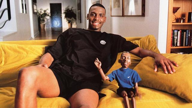 Penny Hardaway sits next to his alter-ego Lil' Penny as part of a 90s Nike sneaker campaign.