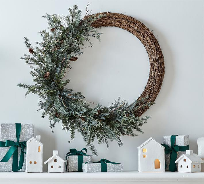 "<p>potterybarn.com</p><p><strong>$20146.00</strong></p><p><a href=""https://go.redirectingat.com?id=74968X1596630&url=https%3A%2F%2Fwww.potterybarn.com%2Fproducts%2Fasymmetrical-faux-pine-wreath%2F&sref=https%3A%2F%2Fwww.elledecor.com%2Fdesign-decorate%2Fg2825%2Fbest-christmas-wreaths%2F"" rel=""nofollow noopener"" target=""_blank"" data-ylk=""slk:Shop Now"" class=""link rapid-noclick-resp"">Shop Now</a></p><p>Made out of faux pine branches, this wreath is the perfect touch for a rustic look–indoors or outdoors.</p>"