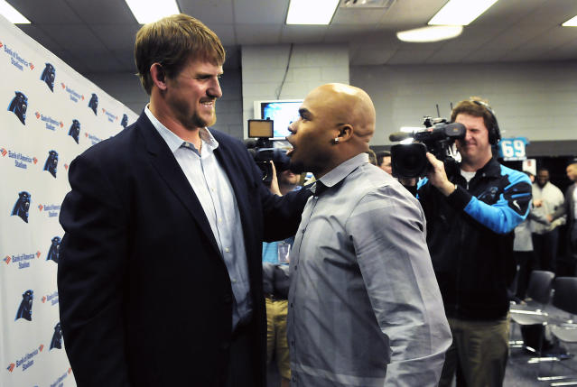 Carolina Panthers offensive tackle Jordan Gross greets now former teammate Steve Smith after Gross' news conference to announce his retirement after 11 seasons as a pro football player in Charlotte, N.C., Wednesday, Feb. 26, 2014. (AP Photo/The News & Observer, John D. Simmons)