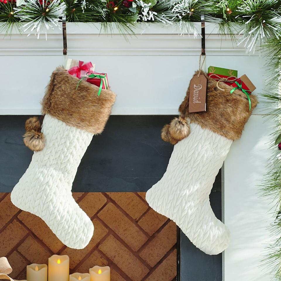 """<p> Santa won't be able to resist stuffing this two-foot long <a href=""""https://www.popsugar.com/buy/Quilted-Velvet-Stocking-487789?p_name=Quilted%20Velvet%20Stocking&retailer=grandinroad.com&pid=487789&price=39&evar1=casa%3Aus&evar9=46570745&evar98=https%3A%2F%2Fwww.popsugar.com%2Fphoto-gallery%2F46570745%2Fimage%2F46570800%2FQuilted-Velvet-Stocking&list1=shopping%2Choliday%2Cchristmas%2Cchristmas%20decor%2Chome%20shopping&prop13=api&pdata=1"""" rel=""""nofollow"""" data-shoppable-link=""""1"""" target=""""_blank"""" class=""""ga-track"""" data-ga-category=""""Related"""" data-ga-label=""""http://www.grandinroad.com/quilted-velvet-stocking/1295488?listIndex=0"""" data-ga-action=""""In-Line Links"""">Quilted Velvet Stocking</a> ($39) full of his favorite presents.</p>"""