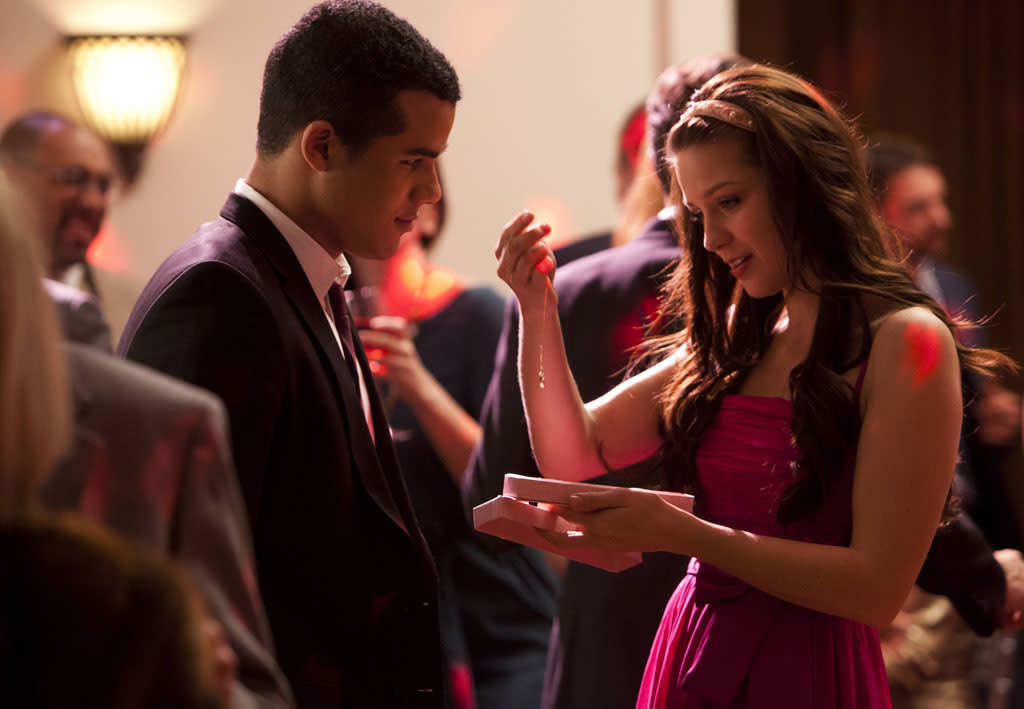 "Jake (Jacob Artist) gives Marley (Melissa Benoist) a Valentine's gift in the ""I Do"" episode of ""Glee."""