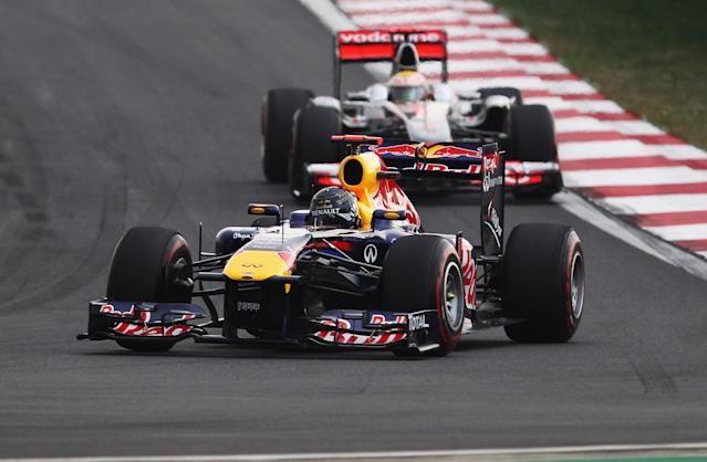 YEONGAM-GUN, SOUTH KOREA - OCTOBER 16: Sebastian Vettel of Germany and Red Bull Racing leads from Lewis Hamilton of Great Britain and McLaren early in the Korean Formula One Grand Prix at the Korea International Circuit on October 16, 2011 in Yeongam-gun, South Korea. (Photo by Clive Mason/Getty Images)