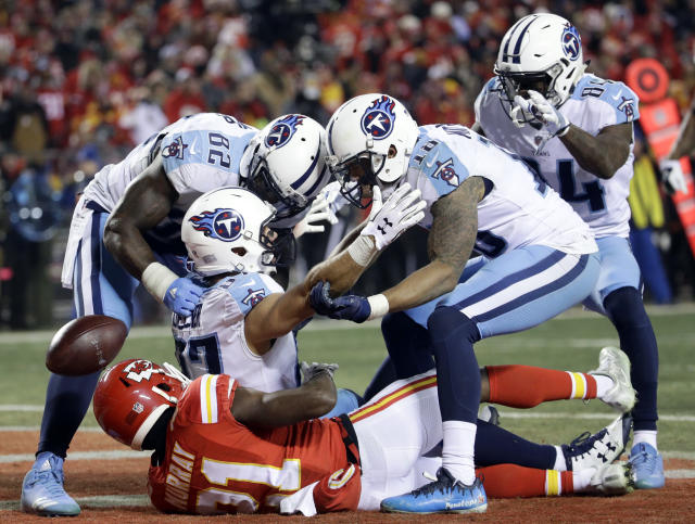 <p>Tennessee Titans wide receiver Eric Decker (87) is congratulated by tight end Delanie Walker (82), wide receiver Rishard Matthews (18), and wide receiver Corey Davis (84) on his 22-yard touchdown catch against Kansas City Chiefs defensive back Eric Murray (21), during the second half of an NFL wild-card playoff football game, in Kansas City, Mo., Saturday, Jan. 6, 2018. (AP Photo/Charlie Riedel) </p>