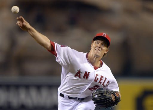 Los Angeles Angels starting pitcher Zack Greinke throws to the plate during the second inning of their baseball game, Tuesday, Sept. 25, 2012, in Anaheim, Calif. (AP Photo/Mark J. Terrill)