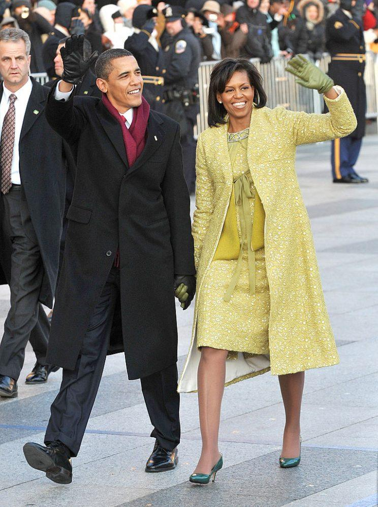 President Barack Obama and first lady Michelle Obama walk in the inaugural parade.
