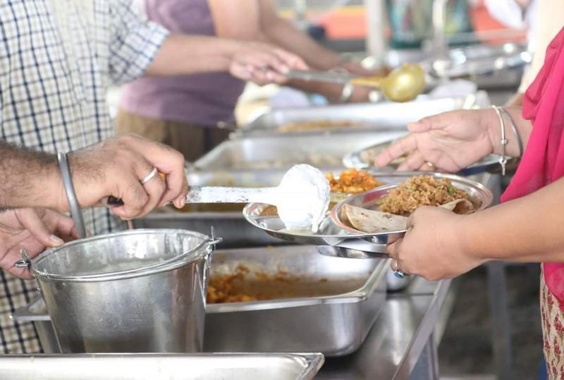 Lunch prepared and served by devotees from PJ gurdwara on Vaisakhi eve. — Picture courtesy of Gurpreet Singh
