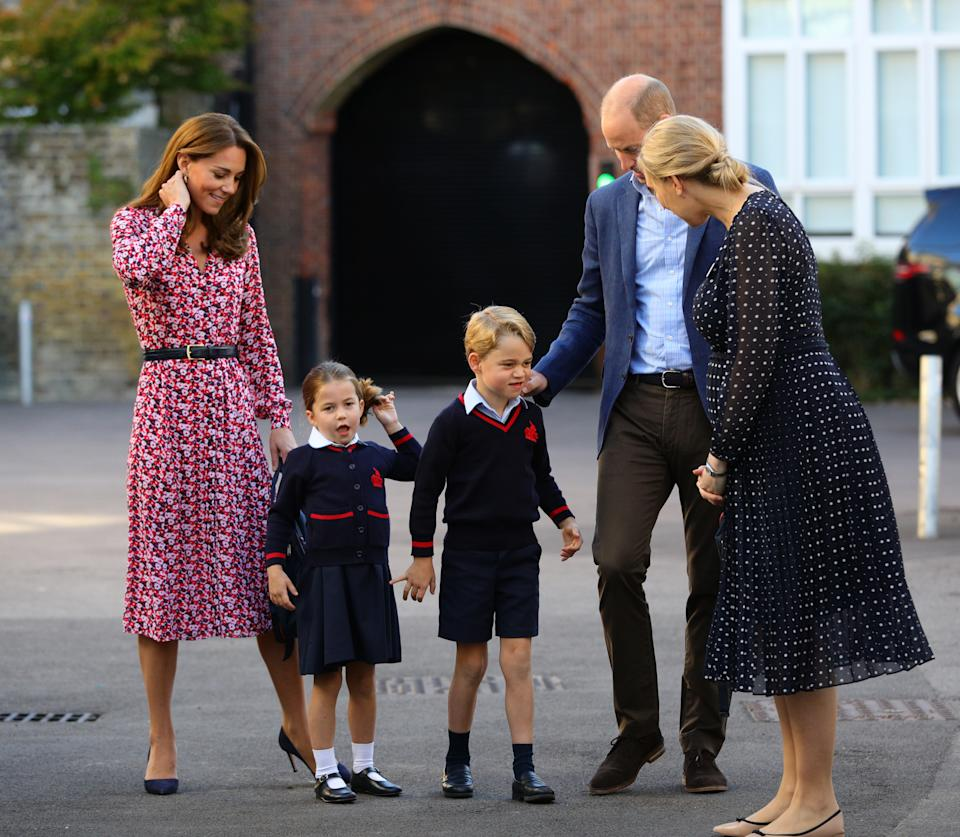 Helen Haslem (right), head of the lower school greets Princess Charlotte as she arrives for her first day of school, with her brother Prince George and her parents the Duke and Duchess of Cambridge, at Thomas's Battersea in London on September 5, 2019 in London, England.