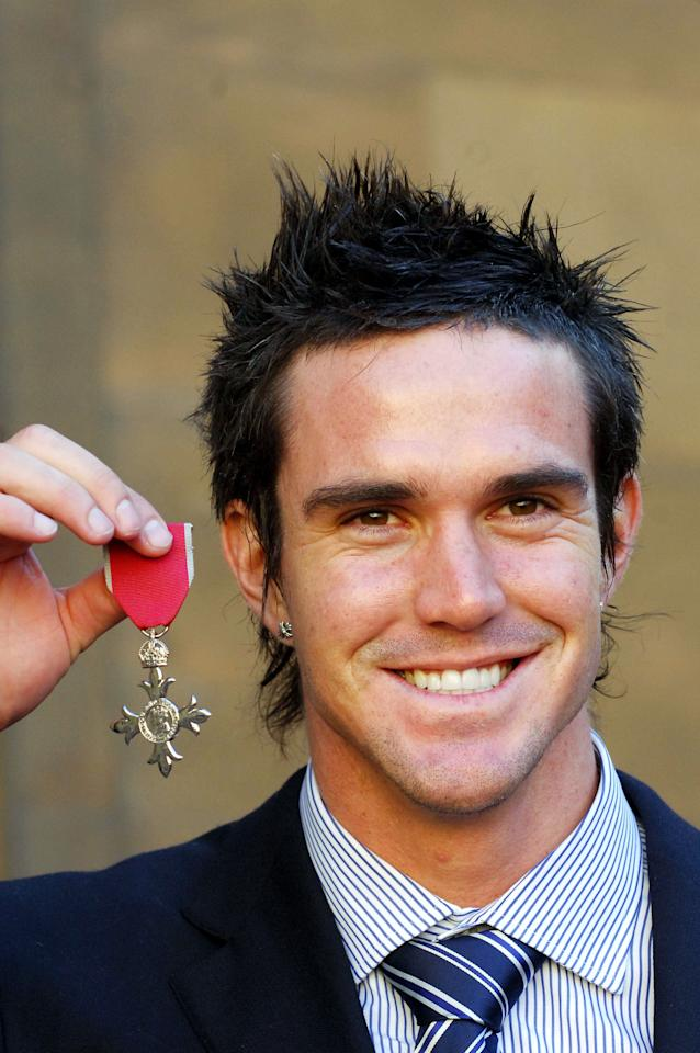 LONDON - FEBRUARY 9: (NO PUBLICATION IN UK MEDIA FOR 28 DAYS) England cricketer Kevin Pietersen poses with his MBE from HM The Queen, awarded in honour of their 2005 Ashes victory over Australia, at Buckingham Palace on February 9, 2006 in London, England. The cricketers joined The Queen and Prince Phillip at a reception following the investiture of the entire men's team, and the captain of the women's team, Clare Connor. Connor and Michael Vaughan both receive OBEs, the rest of the team receive MBEs. (Photo by Pool/Anwar Hussein Collection/Getty Images)