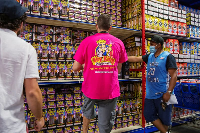 Shoppers look through fireworks for sale at Sky King Fireworks in Morrisville, Pennsylvania
