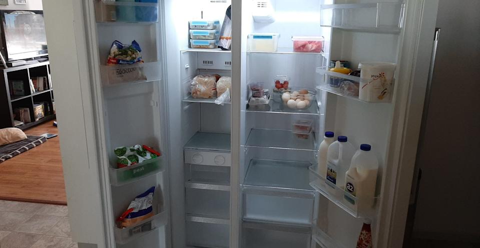 Photo shows the inside of the Gillett family's almost empty fridge.