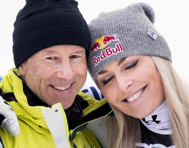 Lindsey Vonn of the United States, right, celebrates with ski legend Ingemar Stenmark of Sweden after the flowers ceremony of the women downhill race at the 2019 FIS Alpine Skiing World Championships in Are, Sweden Sunday, Feb. 10, 2019. (Jean-Christophe Bott/Keystone via AP)