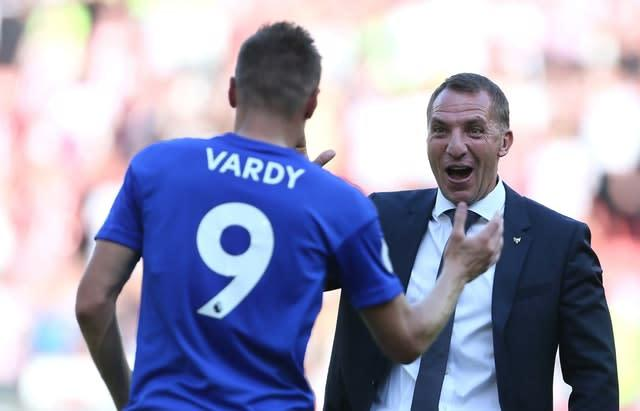 Jamie Vardy, left, is congratulated by Leicester boss Brendan Rodgers (Richard Sellers/PA)