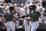 San Diego Padres' Jake Cronenworth (9) and Wil Myers celebrate after scoring on a double by Ha-Seong Kim against the Colorado Rockies in the first inning of a baseball game Sunday, Aug. 1, 2021, in San Diego. (AP Photo/Derrick Tuskan)