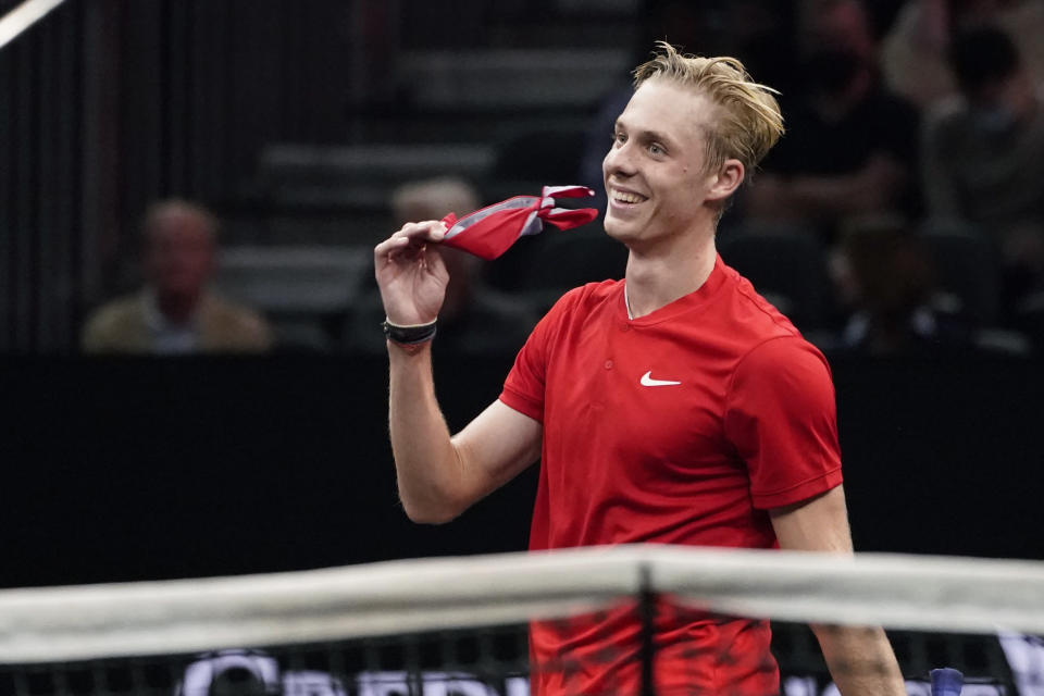 Team World's Denis Shapovalov, of Canada, walks to the net after he was defeated by Team Europe's Daniil Medvedev, of Russia, during Laver Cup tennis, Saturday, Sept. 25, 2021, in Boston. (AP Photo/Elise Amendola)
