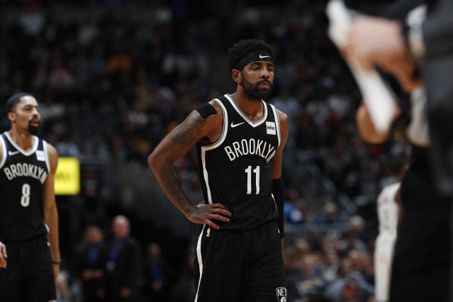 Nets guard Kyrie Irving will miss their next three games, including what would have been his first trip back to Boston since leaving the Celtics. (AP/David Zalubowski)