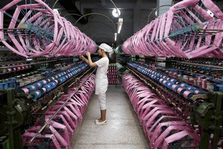 File photo of an employee working inside a silk factory in Neijiang