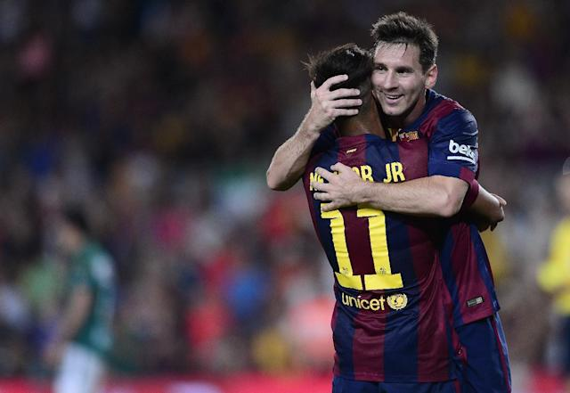 Barcelona's Neymar is congratulated by Lionel Messi during the Joan Gamper Trophy match against Leon Club in Barcelona on August 18, 2014 (AFP Photo/Josep Lago)