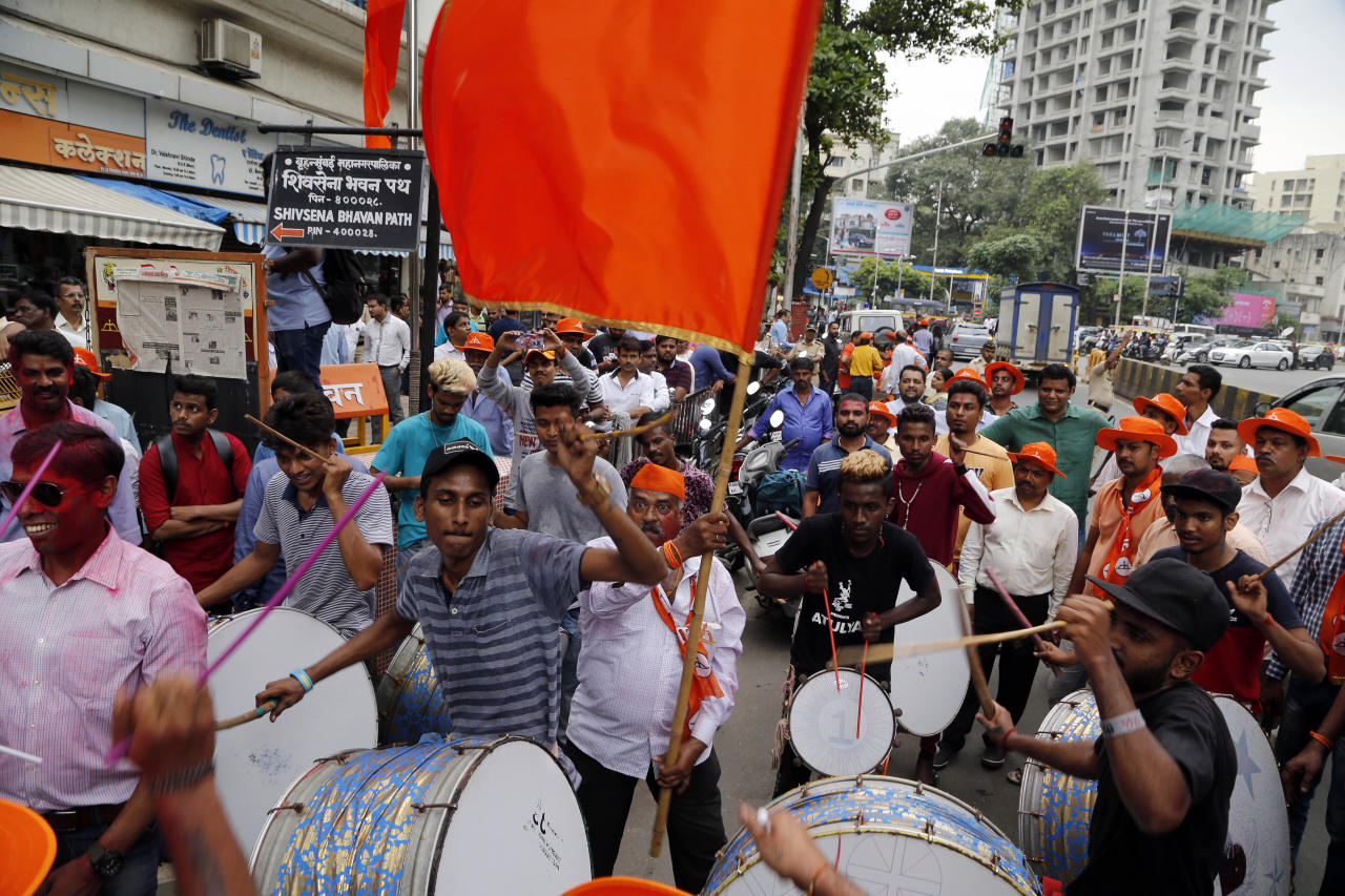 Shiv Sena party supporters celebrate outside their party office in Mumbai, India, Thursday, Oct. 24, 2019. According to preliminary results Thursday, Prime Minister Narendra Modi's Bharatiya Janata Party and Shiv Sena, its regional ally, were leading in the 288-seat assembly in the western state of Maharashtra, home to India's financial capital Mumbai. (AP Photo/Rajanish Kakade)
