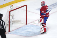 Montreal Canadiens goaltender Carey Price looks back at the puck in the net following a goal by Tampa Bay Lightning's Tyler Johnson during the third period of Game 3 of the NHL hockey Stanley Cup Final, Friday, July 2, 2021, in Montreal. (Paul Chiasson/The Canadian Press via AP)