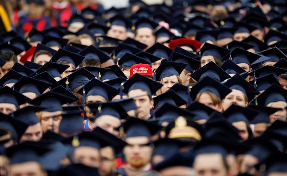 A graduate wears a Make America Great Again hat amidst a sea of mortar boards before the start of commencement exercises at Liberty University in Lynchburg, Virginia, U.S., May 11, 2019.  REUTERS/Jonathan Drake      TPX IMAGES OF THE DAY